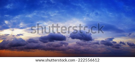 Panorama of beautiful cloudy sky with sunshine over the sea horizon. Natural background - stock photo