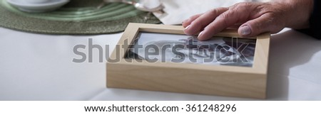 Panorama of bereaved woman yeraning for dead husband - stock photo