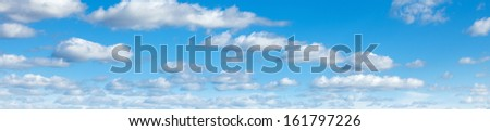 Panorama of blue sky on a sunny day - stock photo