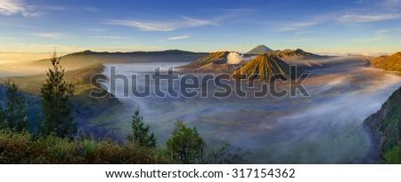 Panorama of Bromo volcano at sunrise,Tengger Semeru national park, East Java, Indonesia - stock photo