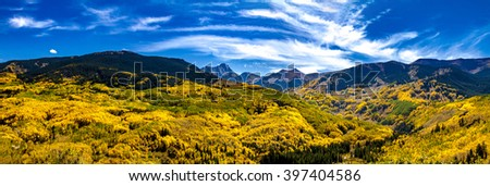 Panorama of Capitol Peak mountain valley in full fall color near Aspen Colorado - stock photo