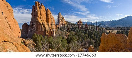 Panorama of Central Garden of the Gods Park near Colorado Springs, Colorado with tourists climbing on the massive megaliths