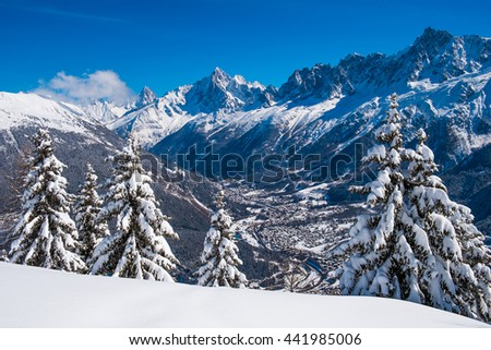 Panorama of Chamonix valley and Mont Blanc Massif in winter from Prarion, Les Houches, France - stock photo