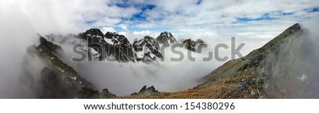 Panorama of cloudy high mountains. Tatra Mountains. - stock photo