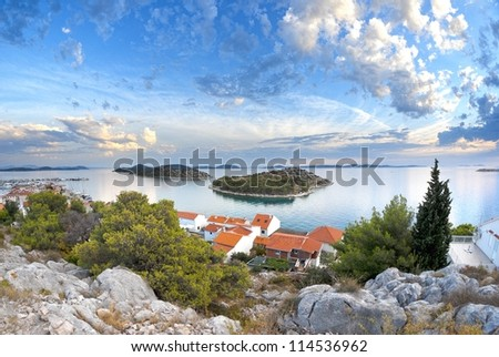 Panorama of coast, islands and old town, Croatia Dalmatia Tribunj - stock photo