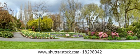 panorama of colorful blooming spring park - stock photo