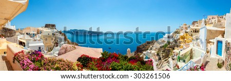 Panorama of colorful houses in Oia town, Santorini island - stock photo