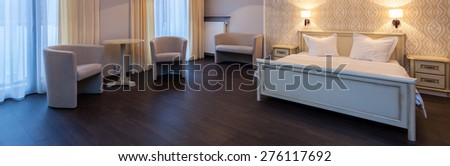 Panorama of comfortable and elegant hotel room  - stock photo