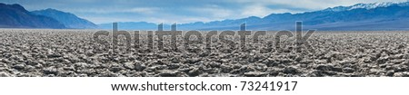 Panorama of Devil's Golf Course in the Badwater Basin.  The Devil's Golf Course is a large salt pan on the floor of Death Valley in the Badwater Basin. - stock photo