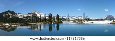 Panorama of diamond head lake in Garibaldi National Park in British Columbia during spring - stock photo