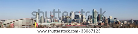 Panorama of Downtown Calgary with Saddledome in the foreground