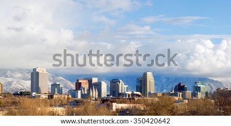Panorama of downtown Salt Lake City in the winter with low clouds and mountains in the background, Utah, USA