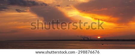 panorama of dramatic sunset over the bay