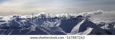 Panorama of evening mountains. Caucasus Mountains, Georgia, ski resort Gudauri. - stock photo
