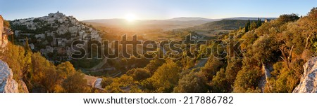 Panorama of famous Gordes medieval village and provencal countryside sunrise view, Provence, France - stock photo