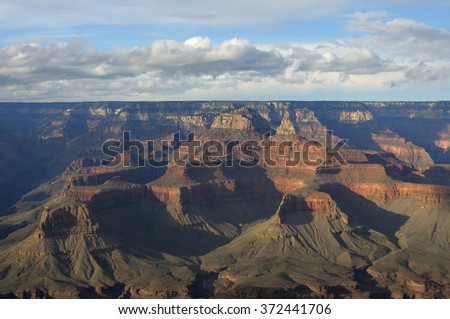 Panorama of Grand Canyon at early summer with clouds and shadows. Arizona. USA