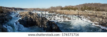 Panorama of Great Falls on Potomac river outside Washington DC in winter with ice forming on the cascades and snow on the rocks - stock photo