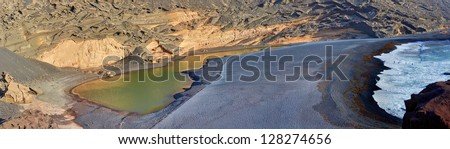Panorama of Green Lake /green Lagoon - Charco de los Clicos - inside volcanic crater - El Golfo, Lanzarote, Canary Islands, Spain. - stock photo