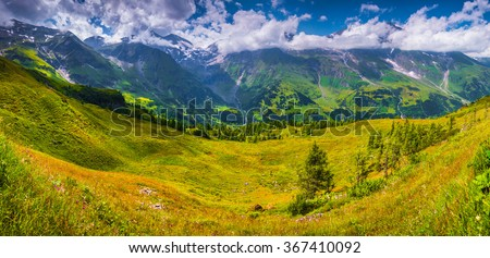 Panorama of Grossglockner mountain range from Grossglockner High Alpine Road. Sunny summer landscape of Austria, Alps, Europe. - stock photo