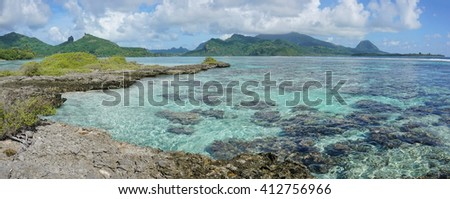 Panorama of Huahine island with shallow water of its lagoon, seen from an islet, near Maroe bay, Pacific ocean, French Polynesia - stock photo