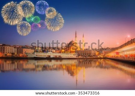 Panorama of Istanbul at a dramatic sunset from Galata Bridge with fireworks, Istanbul, Turkey - stock photo