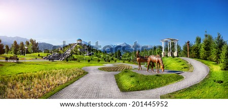 Panorama of Kazakh monuments and horses statues in dendra park of first president Nursultan Nazarbayev in Almaty, Kazakhstan