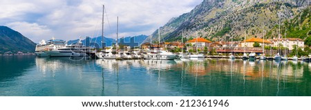 Panorama of Kotor port with the fishing boats, large yachts and cruise liner, Montenegro. - stock photo