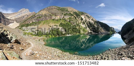 Panorama of Lake Agnes & Mount Niblock, St. Piran, Lake Louise, Banff National Park, Alberta, Canada  The trail to to Bee Hive and hikes beyond.  - stock photo