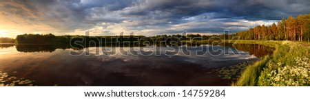 Panorama of lake at sunset with reflection in Finland - stock photo