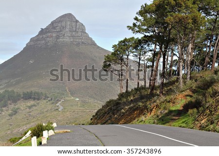 Panorama of Lions Head, Cape Town, South Africa, with the road from Signal Hill leading towards it. Focus on the road. - stock photo