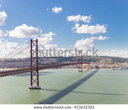 Panorama of Lisbon cityscape with 25 de Abril suspension Bridge, Portugal - stock photo