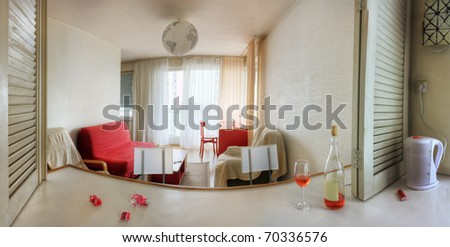 Panorama of living room with stress on red colors - stock photo