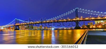 Panorama of Manhattan Bridge in New York City at night - stock photo