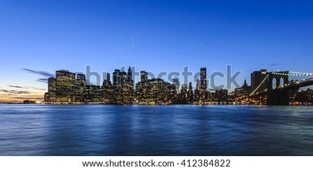 panorama of Manhattan Skyline at evening after sunset seen from Brooklyn Bridge Park, New York City, USA  - stock photo