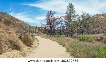 Panorama of meadow in a canyon of southern California. - stock photo