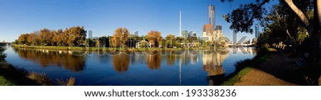 panorama of melbourne on a sunny autumn day with yarra river in foreground - stock photo