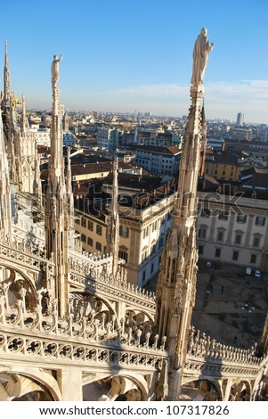 Panorama of Milan from the roof of the Duomo cathedral, Royal Palace in background, Lombardy, Italy - stock photo