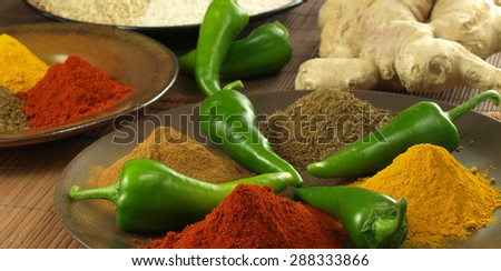 Panorama of mixed different spices and roots - stock photo