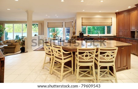 Panorama of Modern Kitchen with Island in Luxurious New Home - stock photo