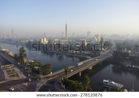 Panorama of morning Cairo, overlooking the Nile. Light haze, Egypt. Cold colors. Landscape