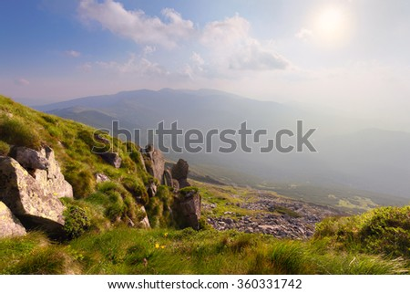 Panorama of mountain hills at sunny day - stock photo