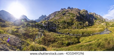 panorama of mountain landscape early morning rising of the sun with meadow, located in the river valley in Abkhazia, the Caucasus Mountains - stock photo
