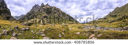 panorama of mountain scenery with meadow, located in the valley of the river warm summer day in Abkhazia, the Caucasus Mountains - stock photo