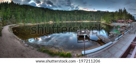 Panorama of Mummelsee Lake in the Black Forest at dusk in Baden-Wurttemberg, Germany - stock photo