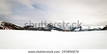 Panorama of Norris glacier in Alaska and mountain range in the far distance - stock photo