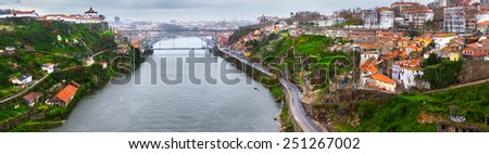 Panorama of old town Porto, Portugal. Douro river and the Dom Luis Bridge. - stock photo