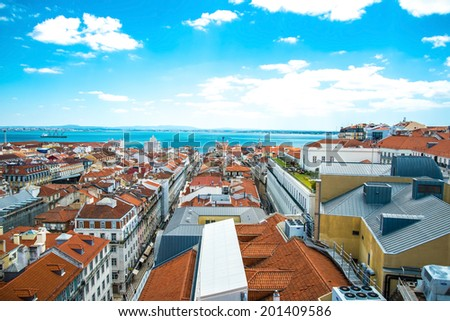 Panorama of old traditional city of Lisbon with red roofs - stock photo