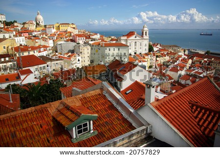 Panorama of old traditional city of Lisbon with red roofs and view of river Tagus - stock photo