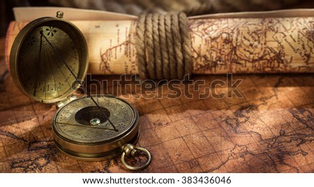 Panorama of old vintage retro compass on ancient world map. Vintage still life. Travel geography navigation concept background.