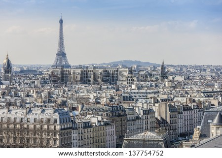 Panorama of Paris from top of the Notre dame de Paris. Eiffel tower in the background. France. - stock photo